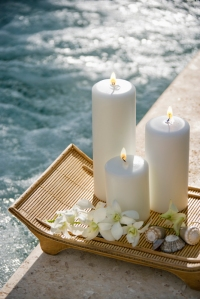 Candles by pool.