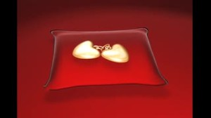gold-lockets-on-red-pillow_wjx7kv7bs__S0000