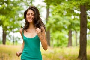 5188484-beautiful-young-woman-running-or-jogging-through-a-forest-healthy-life-and-sport-concept